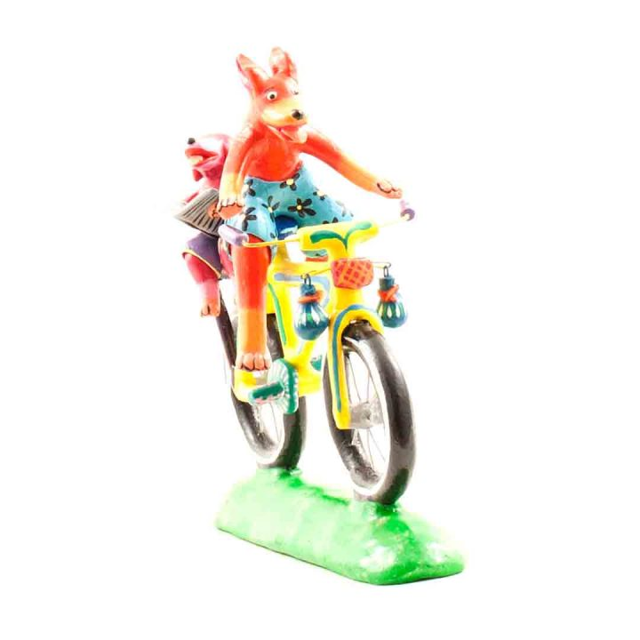 Ortega family pig on a bicycle
