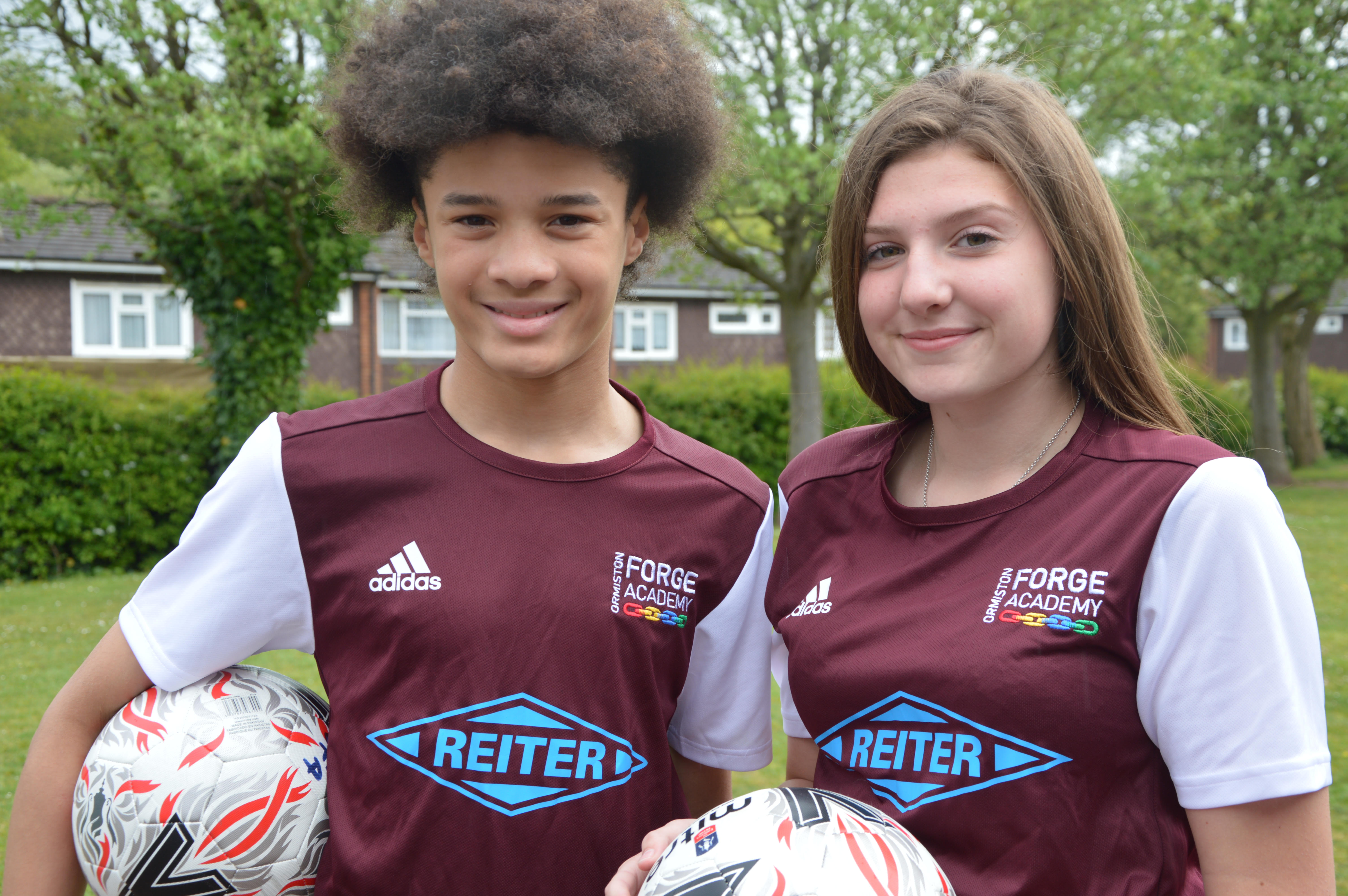 Forge footballers, Zacharia and Danielle, wearing the new sponsored shirts.