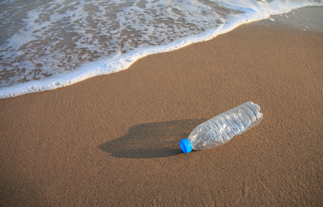 Plastic bottle lying on the beach