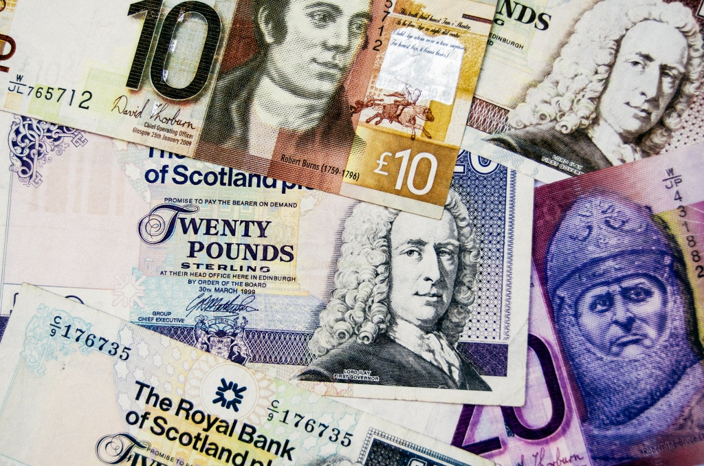 a pile of Scottish banknotes
