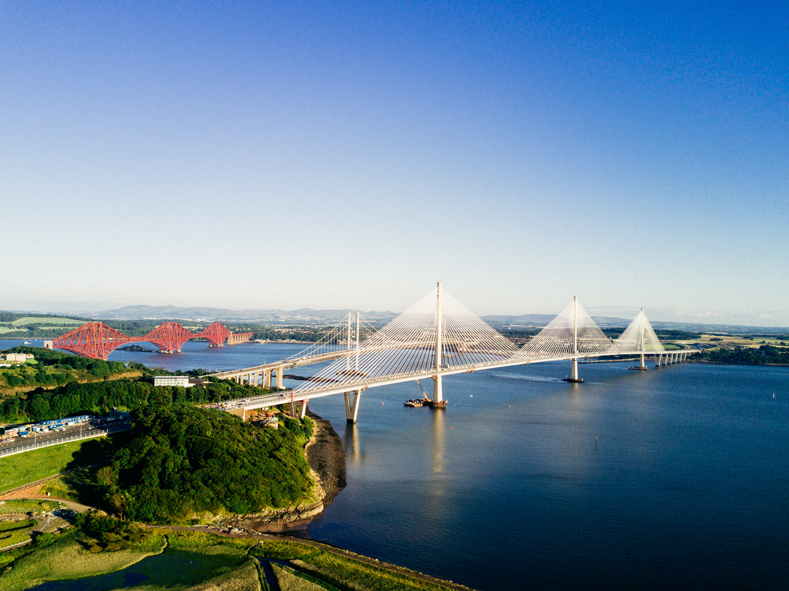 Queensferry Crossing with the Forth Road Bridge and the Forth Bridge behind it
